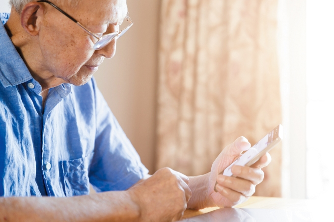 Senior Man Using a Smartphone